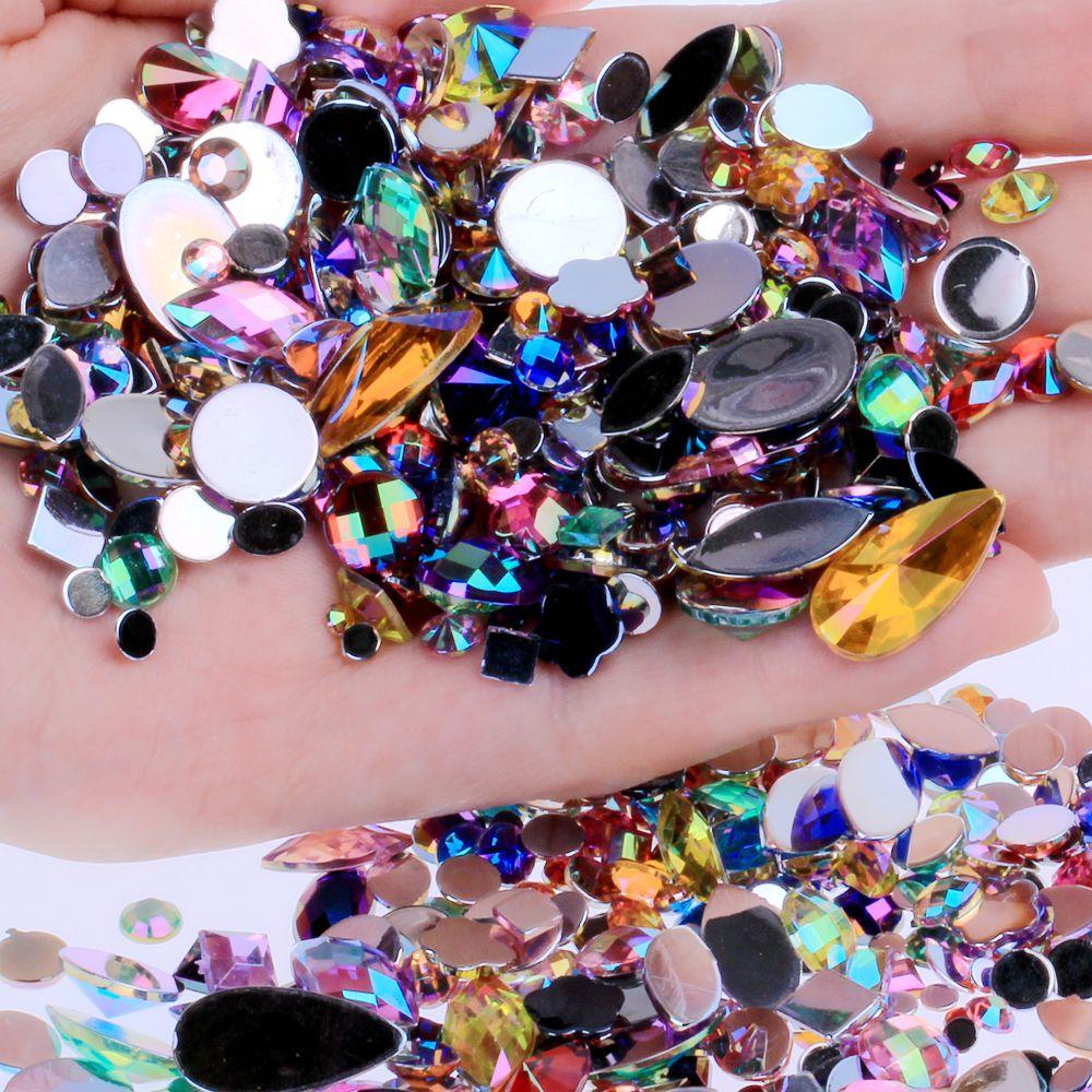 15 г в упаковке около 300 шт. Акриловые стразы с плоским основанием разных форм и размеров, много цветов для украшения лица, драгоценные камни