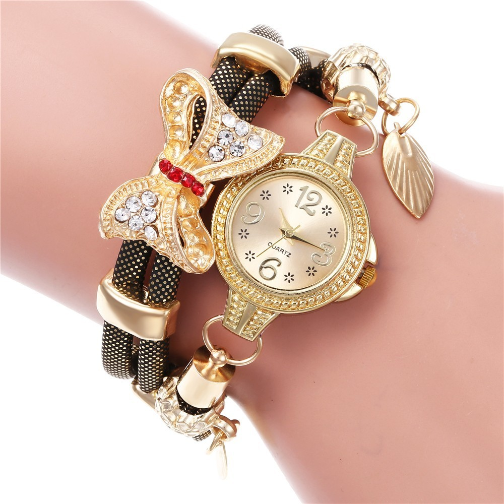 Hot selling retro bracelet watch women high quality exquisite bow-knot leave pendant quartz relogio feminino reloj mujer watchesHot selling retro bracelet watch women high quality exquisite bow-knot leave pendant quartz relogio feminino reloj mujer watches