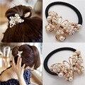 Nuevo 2016 venta caliente de moda mujeres accesorios para el cabello a estrenar de la perla Bungees deber Chic mariposa vendas elásticos del pelo cuerdas pelo de moda
