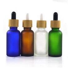 100 個 30 ミリリットルエッセンシャルオイルガラスボトル 1 オンスガラススポイトボトル竹キャップガラスエッセンシャルオイルボトル化粧品包装
