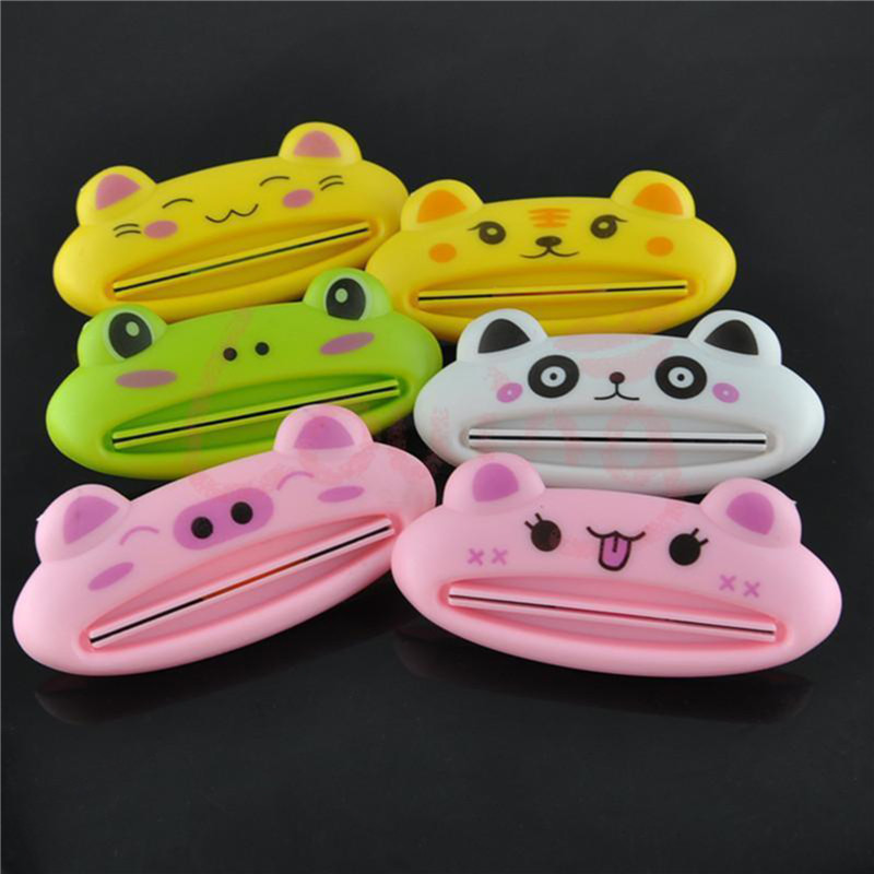 1pcs Cute Plastic Toothpaste Tube Squeezer Bathroom House Tube Roling Holder Easy-using Toothpaste Dispenser Color Random