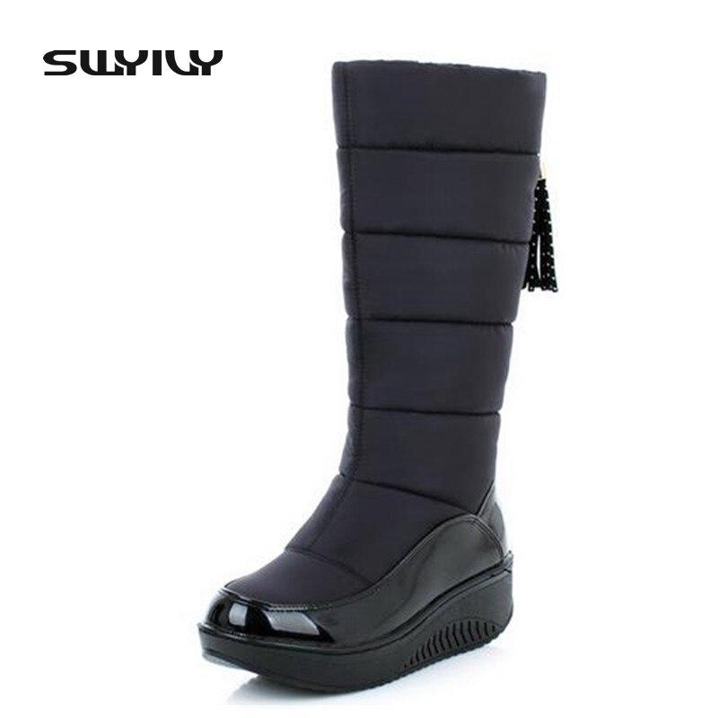 2017 botas de invierno de la borla impermeable de las mujeres cálidas botas de nieve de felpa corta antideslizante a prueba de viento en la mujer zapatos de cuña más tamaño 42 43 44