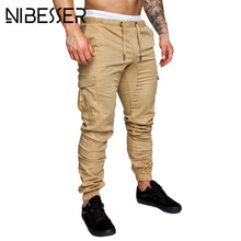 NIBESSER más tamaño 4XL 3XL hombres pantalones Hip Hop Harem moda sólida  elástica cintura Pantalones Casual bolsillos para hombr. 22f2c550bc8