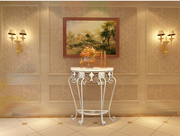 Porch ark. American sitting room, wrought iron half round. Decorative wall.