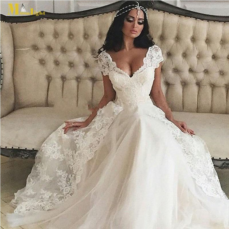 Buy sexy middle east wedding dress deep v for Wedding dress appliques suppliers