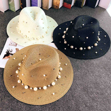 2019 New Summer British pearl beading flat brimmed straw hat Shading sun Lady beach Sunscreen fashion jazz cap