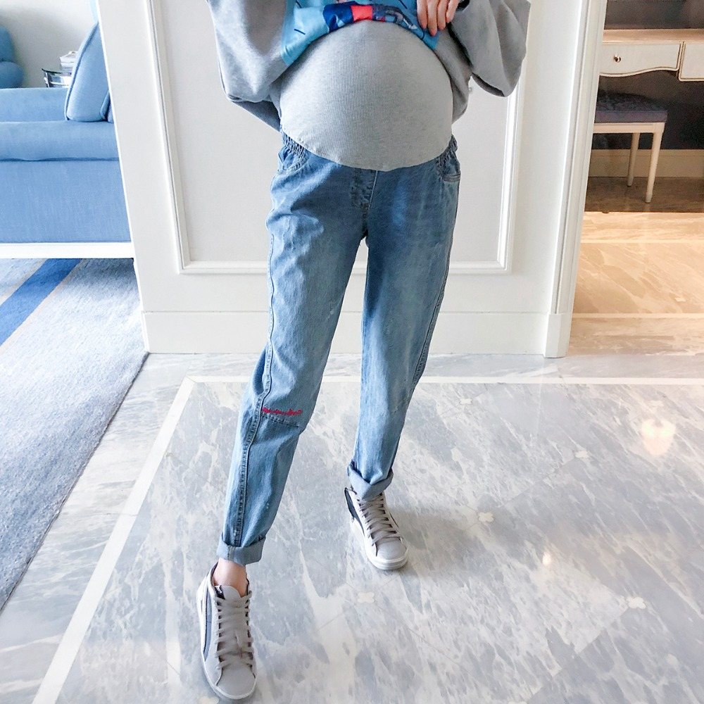 Pregnant women jeans fashion models autumn new embroidered trousers wear wild straight pants tide mother stomach pants