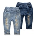 Niños jeans rasgados 2015 moda vaquera cabritos de la ropa de los niños del bebé de los pantalones vaqueros para niños marca delgada pantalones casuales