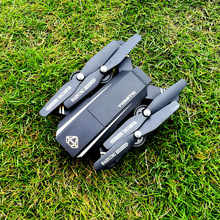 DM95 Headless RC Helicopter WIFI FPV With Wide Angle HD Camera Altitude Hold Mode Foldable Arm RC Quadcopter Drone