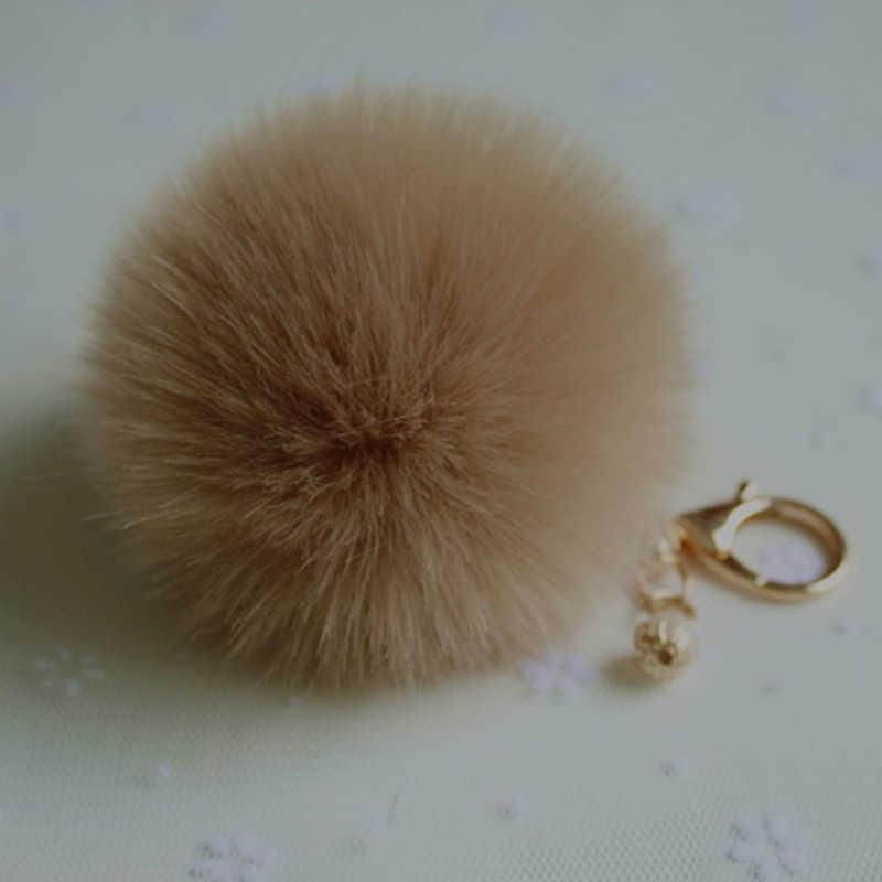 De moda suave pompón conejo piel Pom llavero de clave de la cadena de las mujeres bolsa de encanto anillo de oro coche llave anillo regalo de la joyería