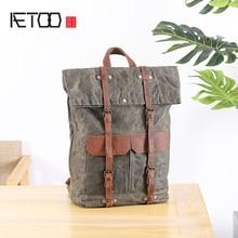 купить AETOO Shoulder bag male canvas stitching cowhide Outdoor travel bag Large capacity mountaineering bag casual backpack по цене 3883.21 рублей