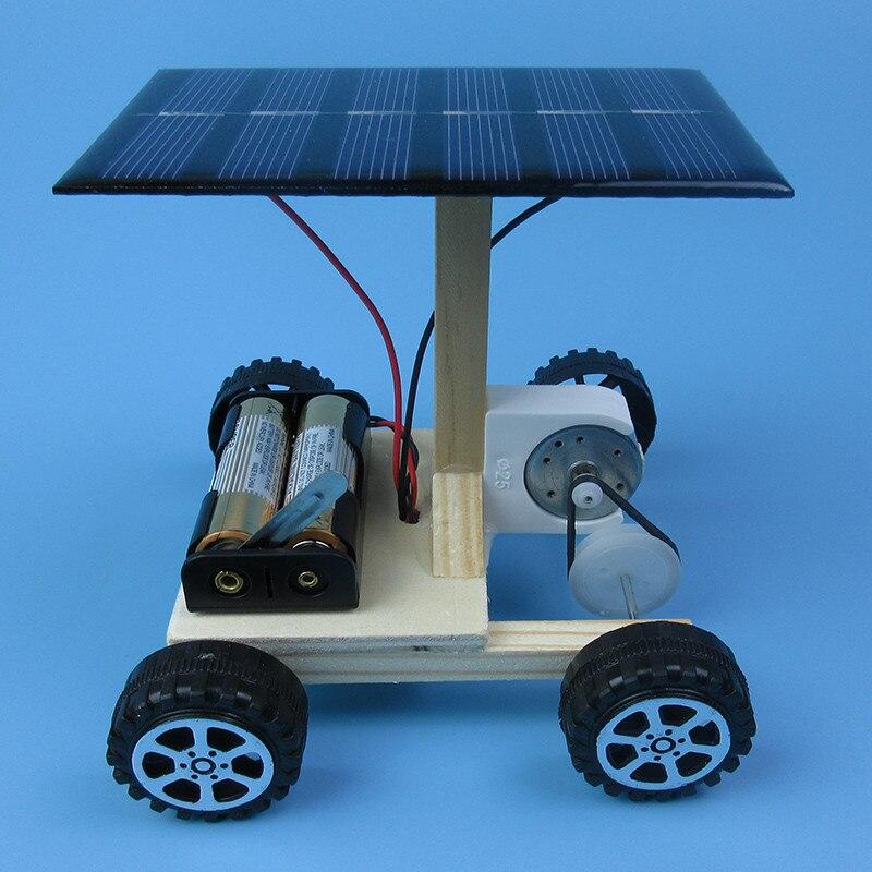 DIY montaje de mano de generación de energía eléctrica solar combinación de vehículos impulsados tecnología de Física de automóviles gizmo