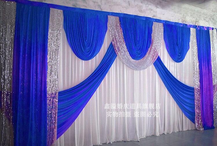 Toile de fond de mariage avec rideau bleu royal avec décoration de mariage en paillettes argentées