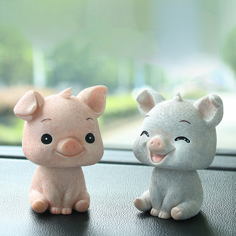 Auto decoration accessories resin material creative car dashboard cartoon 4 kinds of pig gift doll car shaking head ornaments