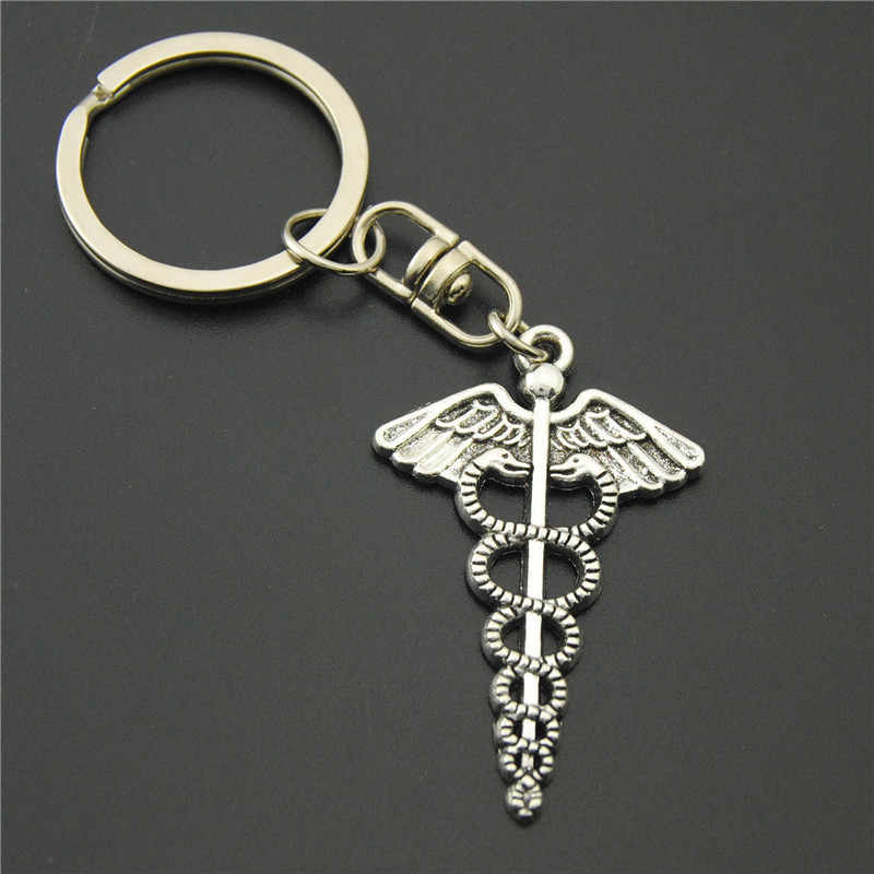 ... 1pc Anitue Silver Sun And Moon Charms Heart Keychains Symbol Mercurial  Staff With Wing Snake Keyring 1eeeda130