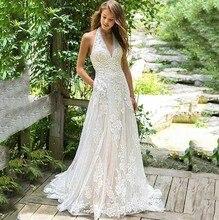 A ラインのウェディングドレスホルターネックレースのアップリケの花嫁ドレス 2019 背中のカスタムメイドのウェディングドレス Vestido デ · ノビア
