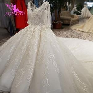 Image 1 - AIJINGYU Hochzeit Kleider China Shiny Weiß Neueste Stil Hochzeit Plus Größe Spitze Kappe Nova Kleid Brautkleid Online Verkauf