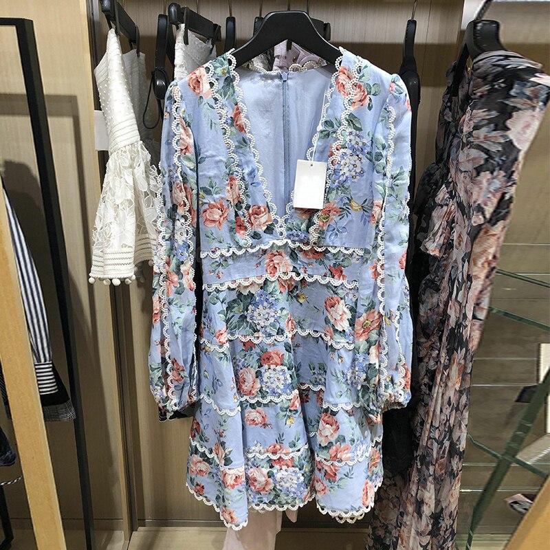Nouveau 2009 printemps femme populaire vacances vent imprimé dentelle de lin bordé profond V Loin une robe de tempérament penduleux