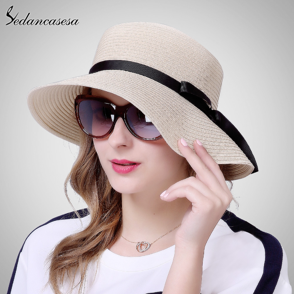 Sedancasesa moda sol hembra sombrero ancho BRIM sombreros de paja para las mujeres  playa del sombrero del sol proteger arco lindo niñas cap SW024053 en ... 82581466af4
