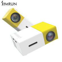 Symrun venta Caliente 2016 Nueva Yellow Mini Proyector LCD 400-600 Lúmenes 320×240 Píxeles de 3.5mm Interfaz de Audio Home Lcd proyector