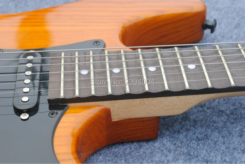 New product. ST double wave electric guitar. ASH yellow groove refers to the board. The real photos. wholesale
