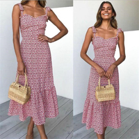 A long pink dress with a halter print for ladies