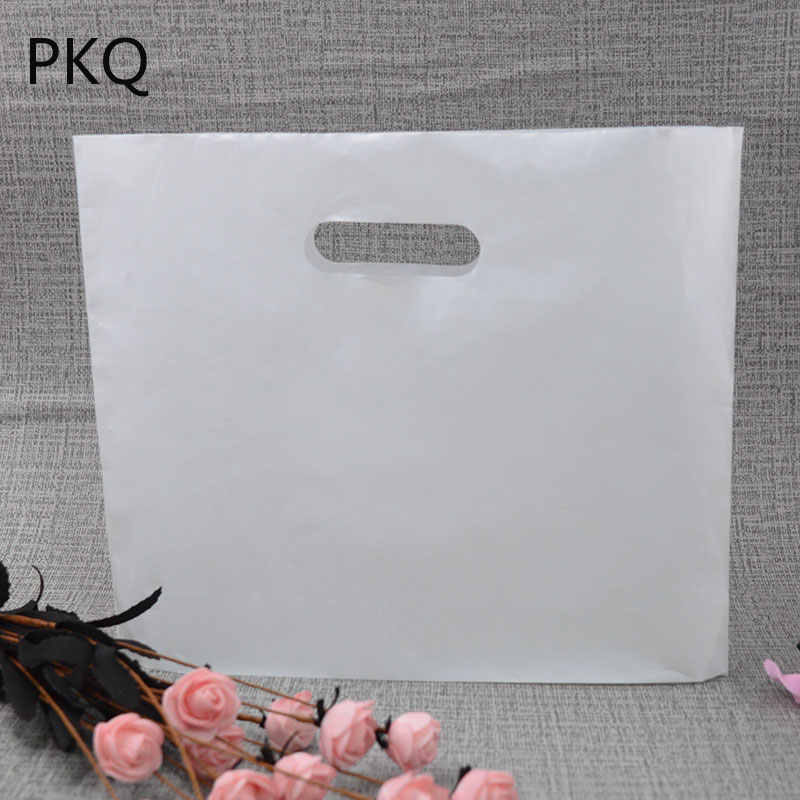 100pcs large Plastic Gift Bags With Handles small Bags For Shops Jewelry Candy Bags Wedding Favors Birthday Party Decoration bag