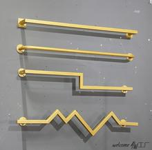 Golden wall hanging rack in clothing store front and side mens womens