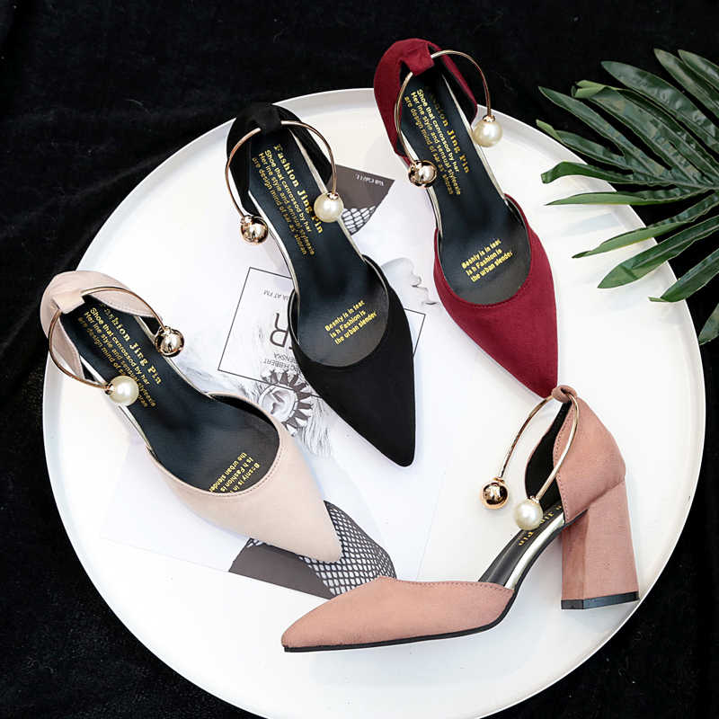 Korean version of the 2019 new shallow mouth high heels fashion wild hollow pearl set foot high heels women's shoes.