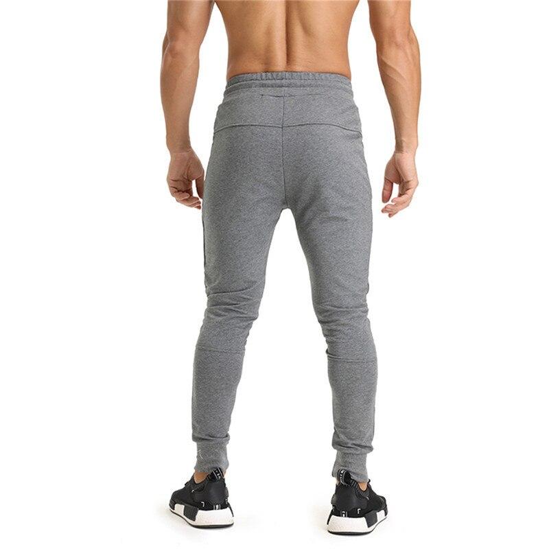 Осень-зима Для мужчин, Цвет боковой молнией Спортивные штаны Бег Фитнес тренажерные залы тренировки Брюки для девочек Треники Jogger Брюки для...