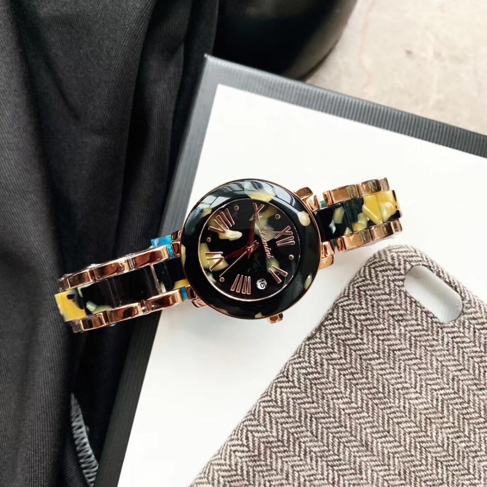 Nouvelle mode neutre femmes été mode montres Cool noir Floral résine montre de haute qualité en plastique Bracelet montre-Bracelet 3Bar