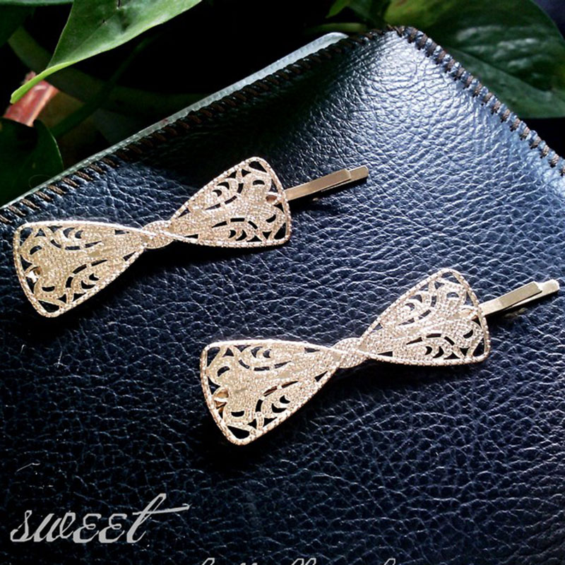 Купить с кэшбэком 2019 Hot Sale Women Girls Elegant gold color Alloy bow shape Hair Clips Barrettes Hairpins Female Hair Styling Accessories F006