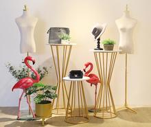 Clothing shop window decoration props display rack, creative womens clothing Golden Window Exhibition