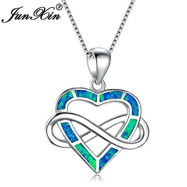 a10aca346657 Junxin amor infinito carta 8 forma cruzadas azul Fire OPAL corazón Colgantes  para las mujeres 925