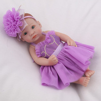 NPK DOLL Mini Reborn Baby Doll 10 inch Girls Gift Kids Playmate Full Vinyl Soft Christmas Gifts Purple Dress Beautiful Collectio