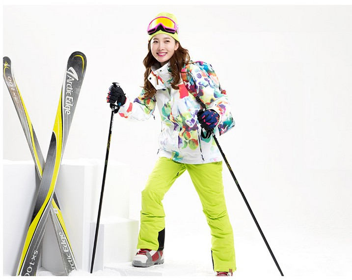 347fa02922a1 Women s ski clothes female riding climbing skiing suit skiwear white ski  jacket and yellow green ski pants with straps bib pants-in Skiing Jackets  from ...