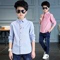 2017 весна лето горячая дети Корейской моде рубашки мальчик Тонкий сплошной цвет косой полосатый карман в юбке хлопка диких дна рубашки