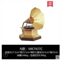 cartoon statue vintage phonograph up the living room European TV cabinet with household decorations wine shop is decorated with