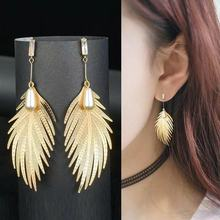 New Temperament  personality simple long golden leaf earrings Jewelry feather earrings for women pearl  bohemian earrings bohemian feather fake gem hook earrings