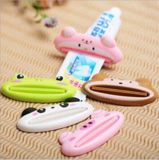1 PC extrusora Manual de pasta de dientes extrusora de cosméticos perezosos extrusora de limpiador facial estantes de almacenamiento de baño OK 0093