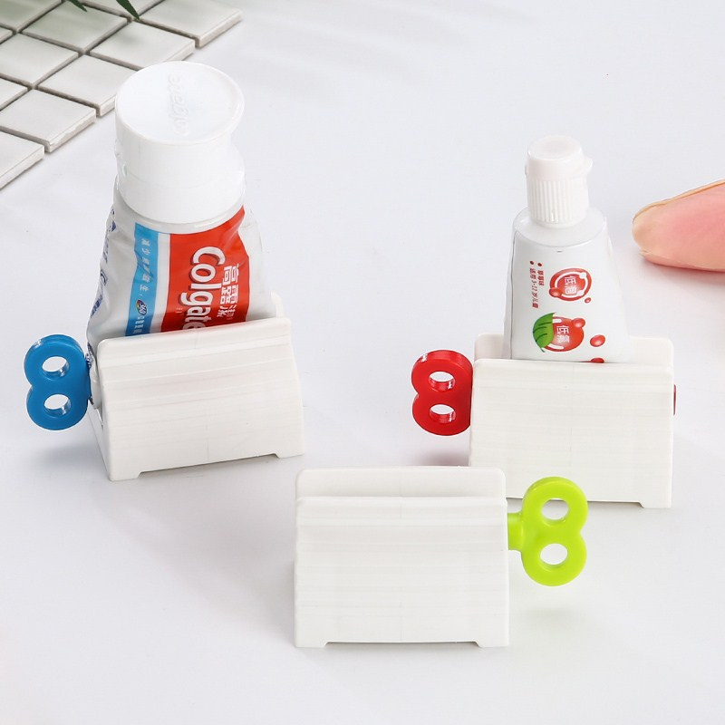 1PC Plastic Rolling Toothpaste Tube Squeezer Dispenser Holder Sucker Hanger Saves Toothpaste Cream Paint Bathroom Accessories