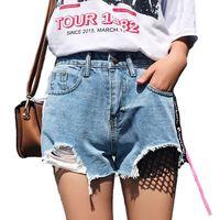 LOSSKY 2018 Zomer Koreaanse Mode Denim Shorts Vrouwen Casual Blauw Kwastje Ripped Knop Hoge Taille Korte Jeans Femme Streetwear