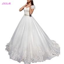 Glamorous Lace Appliques Ball Gown Tull Wedding Dress Sweetheart Short  Sleeve Bridal Dress Long Sheer Back 6e33e48b435e