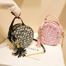 купить Lace Embroidered Small Round Bag 2019 New Korean Fashion Casual Women's Bag Round Tassel Bag Shoulder Diagonal Tote Bag по цене 824.56 рублей