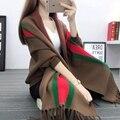 Suéter del espesamiento femenino suéter de otoño e invierno las mujeres camisa del batwing del capote del cabo del capote prendas de vestir exteriores de la raya 2016