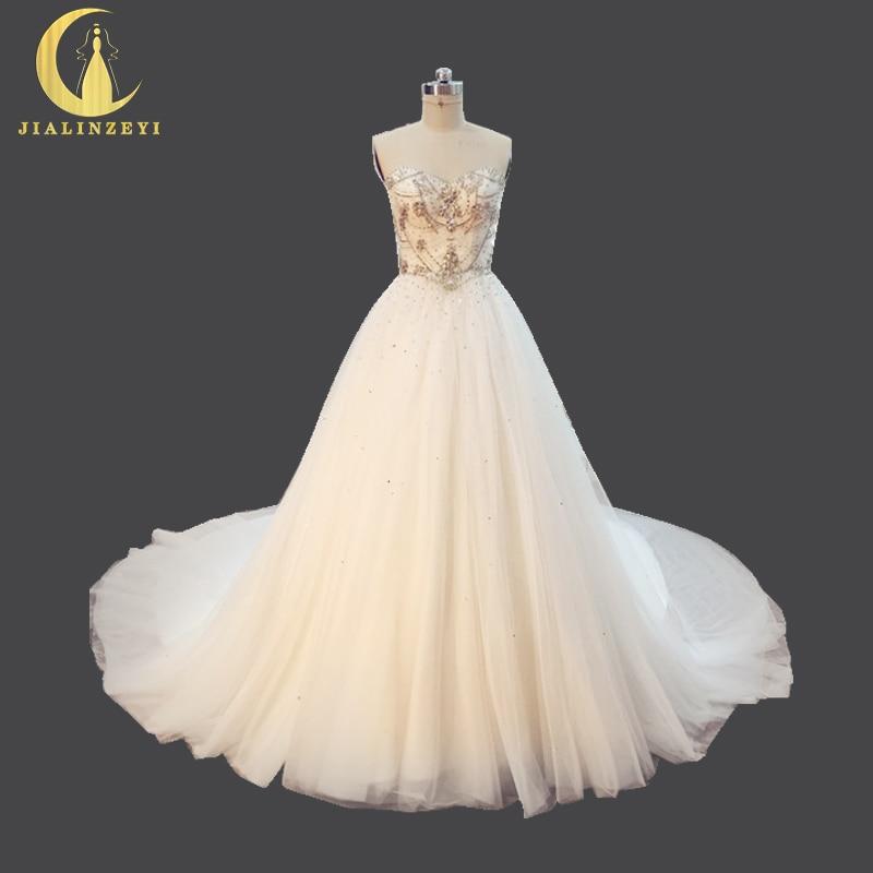 Rýn Skutečný Vzor Luxusní Srdíčko Křišťálové Korálky Sweep Long Train Elegent Svatební Svatební šaty Svatební šaty