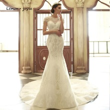 Lemon joyce Luxury Wedding Dresses 2020 Elegant Mermaid Bridal Gowns O Neck Crystal Beading Illusion Dubai robe de mariage