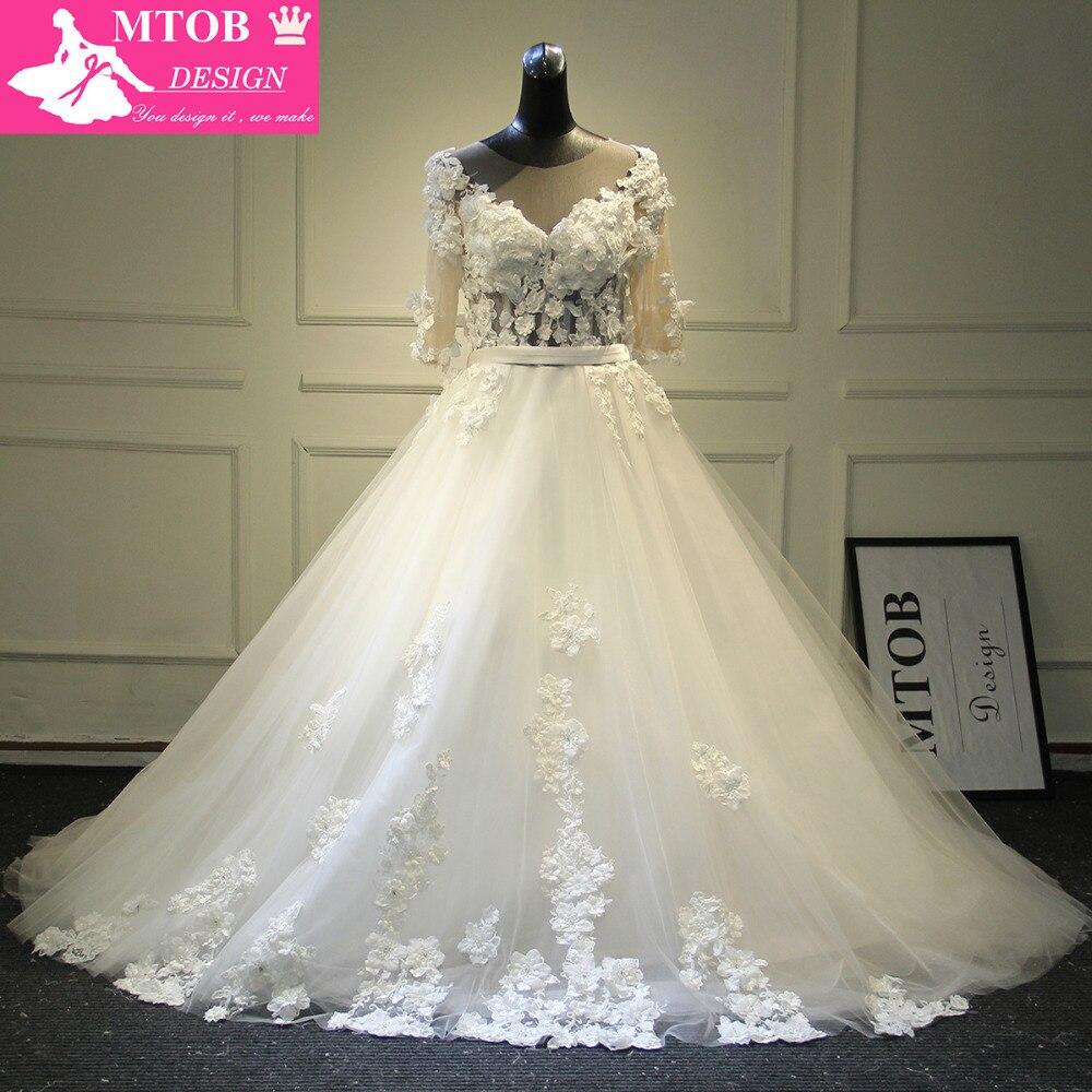 Fashionable 3D Flower Wedding Dress V Neck Half Long Sleeves See Through  Skin Color Tulle Robe e5673fd5eccc