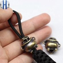 лучшая цена Pure Copper Knife Beads Brass DIY Outdoor Survival Tools Pendant Umbrella Drops Beads EDC Brass Cylinder Skull Paracord Beads