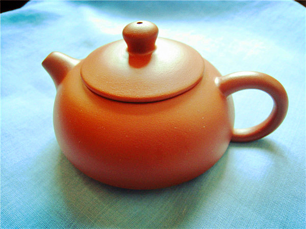 Purple handmade teapot
